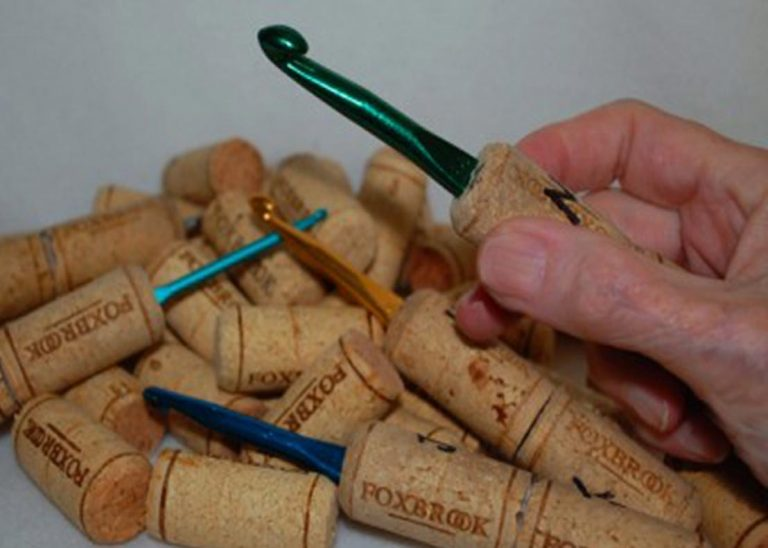 Crochet hoooks covered with wine corks